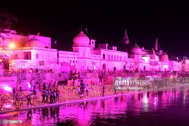 Hindu devotees light earthen lamps on the banks of the River Sarayu on the eve before the groundbreaking ceremony of the proposed Ram Temple in...