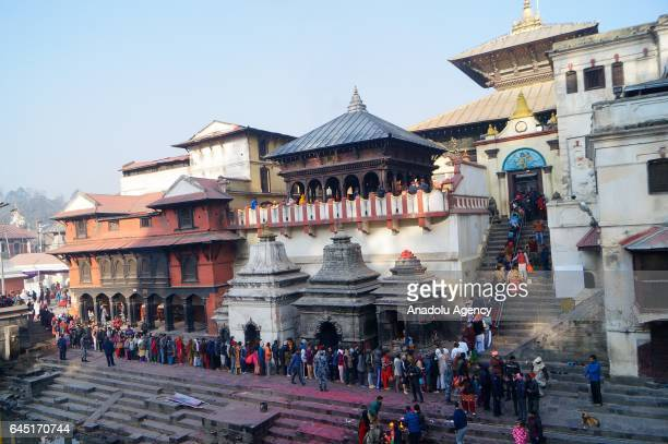 Hindu devotees line up to enter the Pashupatinath temple during the Maha Shivaratri festival in Kathmandu on Nepal February 24 2017 Thousands of...