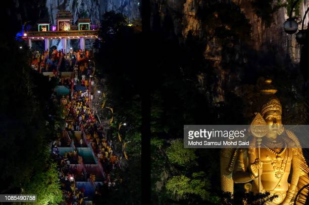 Hindu devotees make their way towards the Batu Caves temple during Thaipusam festivals on January 20 2019 outside Kuala Lumpur Malaysia Thaipusam is...