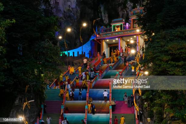 Hindu devotees make their way towards to the Batu Caves temple during the Thaipusam festival on January 18 2019 outside Kuala Lumpur Malaysia...