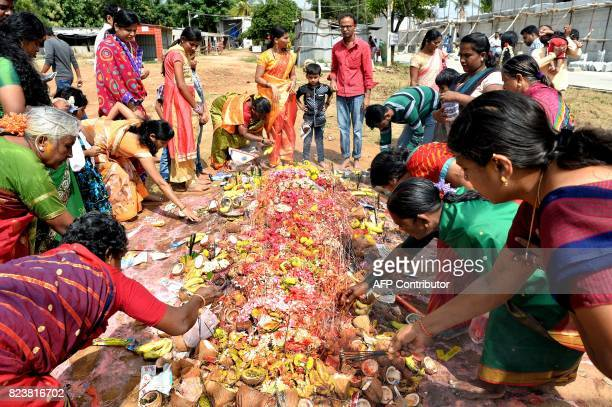 Hindu devotees make various religious offerings to an ant hill which is believed to be the abode of the serpent deity Adishesha at the Mukthi Naga...