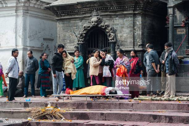 Hindu devotees mourn their family member before cremation at the Pashupatinath Temple one of the holiest shrines of the Hindus as well as UNESCO...