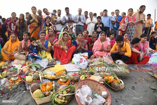 Hindu devotees offer prayer to Sun during Sunset on the occasion of Chhath puja festival at Sangam the confluence of River Ganga Yamuna and...
