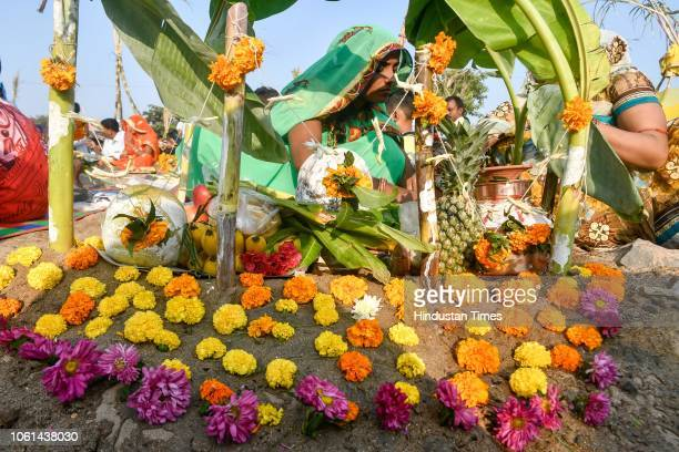 Hindu devotees offer prayers during Chhath Puja at Juhu Beach on November 13 2018 in Mumbai India Thousands of devotees celebrating Chhath Puja...