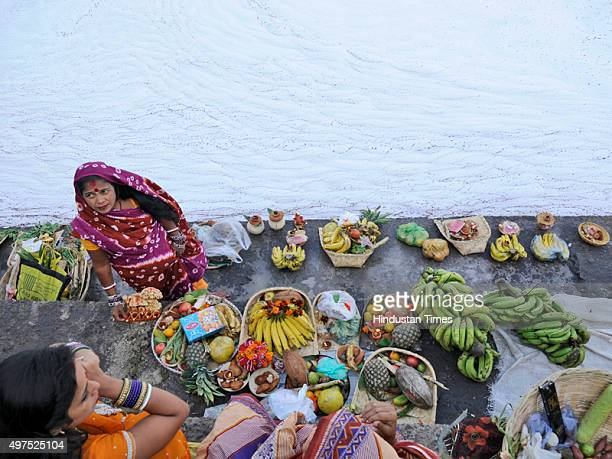 Hindu devotees offer prayers to setting sun during the Chhath festival on the banks of river Yamuna on November 17 2015 in Noida India Chhath...