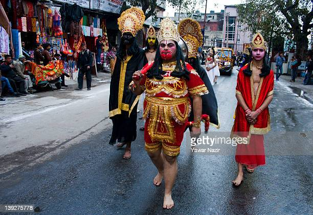 Hindu devotees participate in Hindu religious procession on the eve of Shivratri festival which falls on Monday on February 18 2012 in Jammu the...