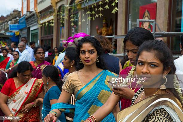 Hindu devotees participate in the annual Tamil chariot festival at the Murugan Temple in Highgate London England Thousands attend the colourful...