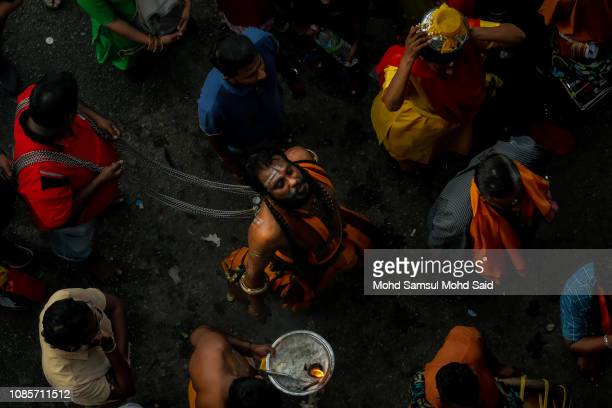 Hindu devotees perform a prayer at Batu Caves temple during Thaipusam festivals on January 21 2019 outside Kuala Lumpur Malaysia Thaipusam is a Hindu...