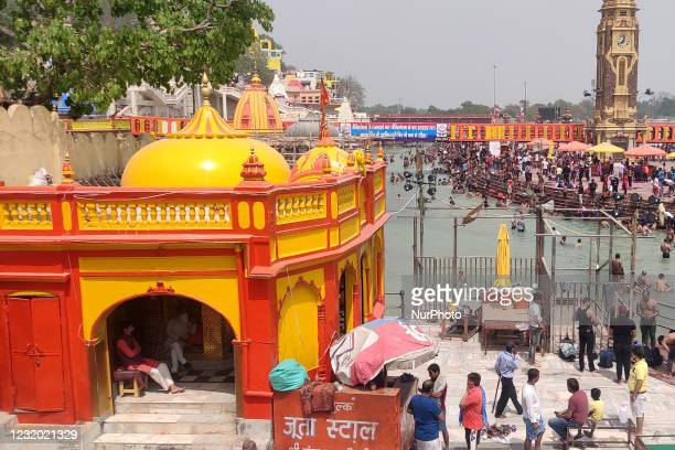 Hindu devotees perform a religious ritual for the departed souls of their relatives on the banks of Ganges river during the ongoing Kumbh Mela...