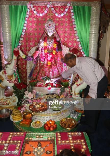 Hindu devotees perform Lakshmi puja during the festival of Diwali at a Hindu temple in Toronto Ontario Canada on November 7 2018 Lakshmi is the Hindu...