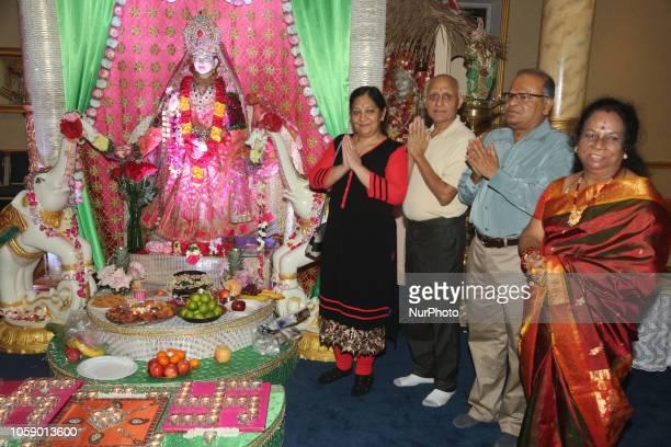 Hindu devotees perform Lakshmi puja during the festival of Diwali at a Hindu temple in Toronto, Ontario, Canada on November 7, 2018. Lakshmi is the...