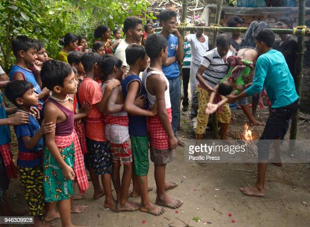 Hindu devotees perform rituals at holy pole during the Charak Puja festival Bengali observes Charak Puja on the last day of Bengali calendar...