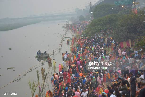 Hindu devotees perform rituals on the occasion of Chhath Puja at Hindon River on November 13 2018 in Ghaziabad India Thousands of devotees...
