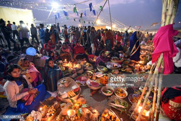 Hindu devotees perform rituals on the occasion of Chhath Puja at Geeta Colony Ghat on November 14 2018 in New Delhi India Thousands of devotees...