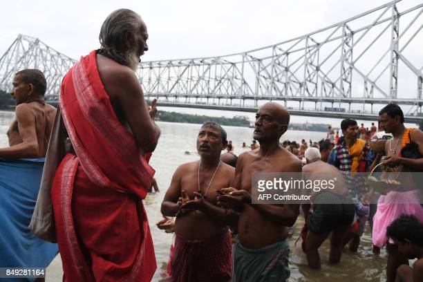 """Hindu devotees perform 'Tarpan' rituals to pay obeisance to their forefathers on the last day of """"Pitrupaksh"""", or days for offering prayers to..."""
