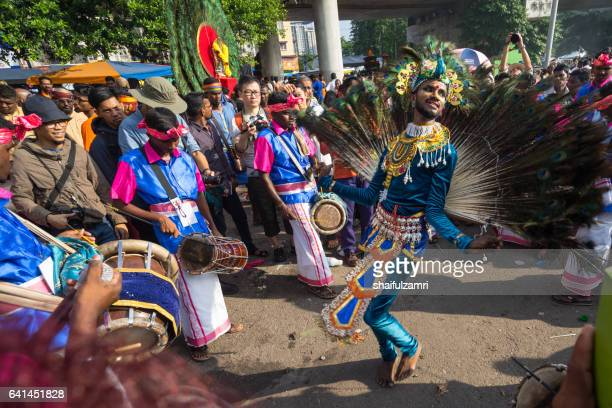 hindu devotees performing a peacock dance  during thaipusam festival - shaifulzamri stock pictures, royalty-free photos & images