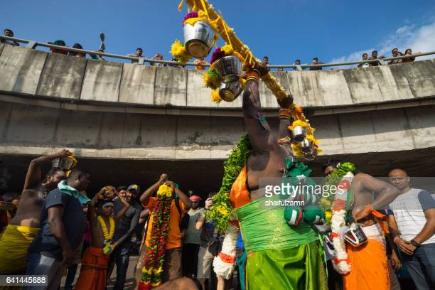 Hindu devotees performing a pray session during Thaipusam festival