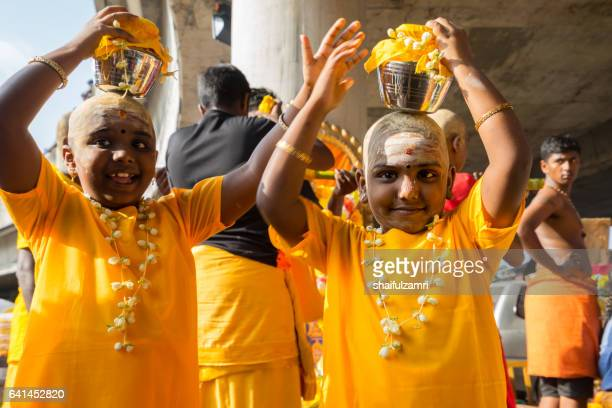 hindu devotees performing a pray session during thaipusam festival - shaifulzamri stock pictures, royalty-free photos & images