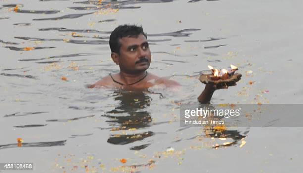 Hindu devotees performing prayer to the rising sun on the occasion of Chhat Festival on October 30 2014 in Bhopal India Chhath puja is a major...
