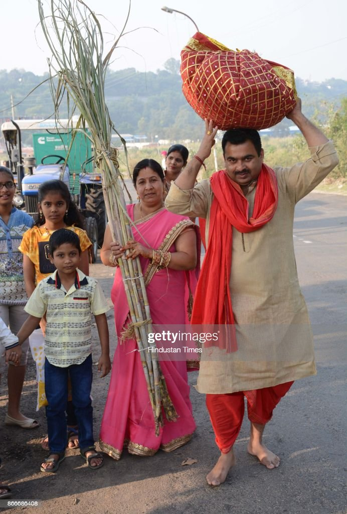 Hindu devotees performing rituals to the God Sun during sunset to mark Chhath Puja festival on October 26 2017 in Panchkula India Thousands of...