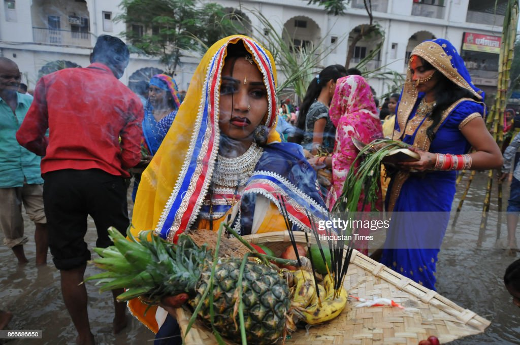 Hindu devotees performing rituals to the God Sun during sunset to mark Chhath Puja festival at Sri Devi Talab Mandir on October 26 2017 in Jalandhar..