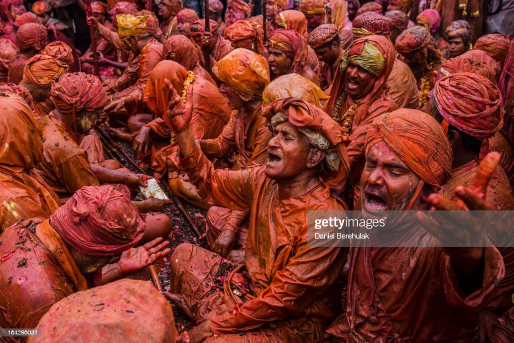 Hindu devotees plays in color during Lathmaar Holi celebrations March 22, 2013 in the village of Nundgaon near Mathura, India. The tradition of playing with colours on Holi draws its roots from a legend of Radha and the Hindu God Krishna. It is believed that young Krishna was jealous of Radha's fair complexion since he himself was himself very dark. After questioning his mother Yashoda on the darkness of his complexion, Yashoda, teasingly asked him to color Radha's face in which ever color he wanted. In a mischievous mood, Krishna applied color on Radha's face. The tradition of applying color on one's beloved is being religiously followed until today.