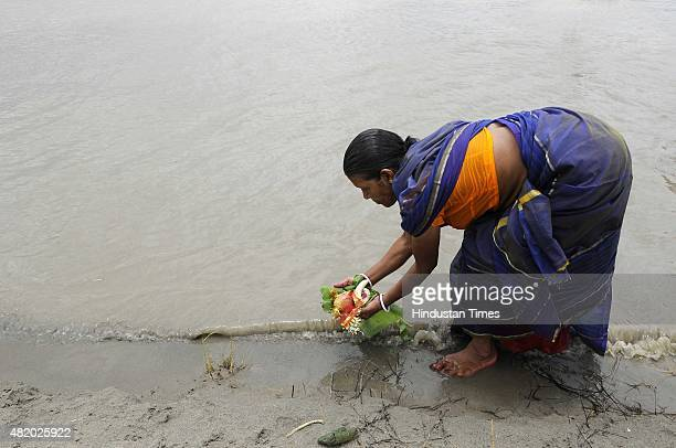 Hindu devotees pray along banks of holy river Yamuna during Jagannath Rath Yatra celebrations, on July 26, 2015 in Noida, India. This year marks the...