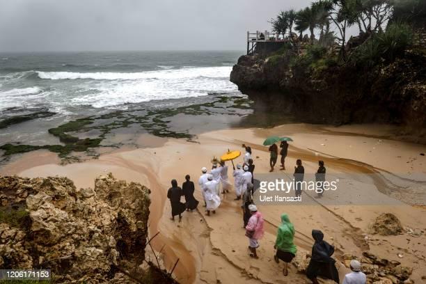 Hindu devotees pray during the Melasti ritual ceremony at Ngobaran beach on March 9, 2020 in Yogyakarta, Indonesia. The Melasti ritual is held...