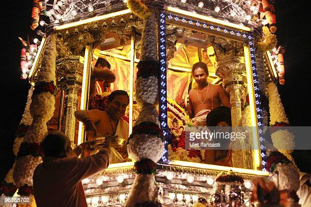 Hindu devotees pray in front of Lord Muruga's chariot during the Thaipusam Hindu festival on January 29 2010 in Kuala Lumpur Malaysia 600000 people...