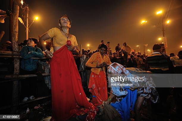 Hindu devotees prepare to bathe in the Ganges river during the Shahi Snan of Mauni Amavasya, the main bathing day of Maha Kumbh Mela.