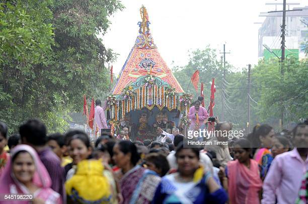 Hindu devotees pull a chariot of Lord Jagannath his brother Balabhadra and sister Subhadra as people gather during the Jagannath Rath Yatra...