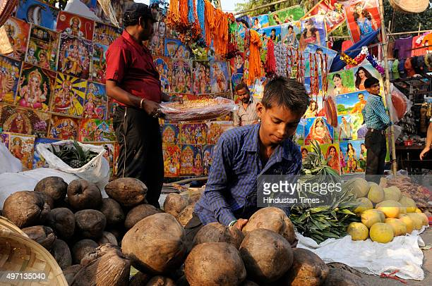 Hindu devotees purchasing religious items for the upcoming Chhath Puja festival at a market, on November 14, 2015 in Noida, India. The Chhath...