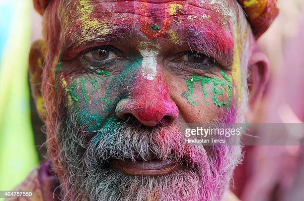 Hindu devotees smeared in colors during Lathmar Holi celebrations at Barsana, Uttar Pradesh, on February 28, 2015 in Vrindavan, India. During Lathmar...