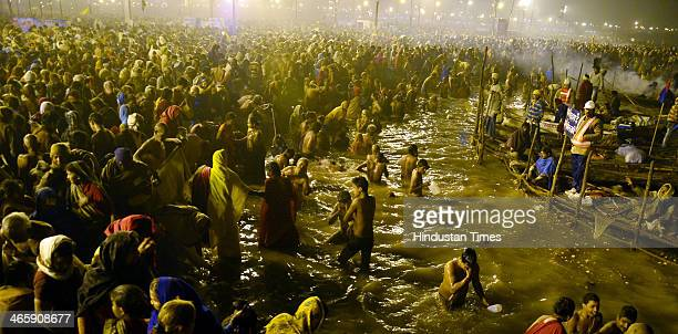 Hindu devotees take a dip in the waters of the holy confluence of Ganga Yamuna and the mythical Saraswati at Sangam on the occasion of Mauni Amavasya...