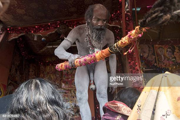 Hindu devotees take a holy bath and perform rituals at the Gangasagar Island around 150 kms south of Kolkata on January 15 2017 More than 700000...
