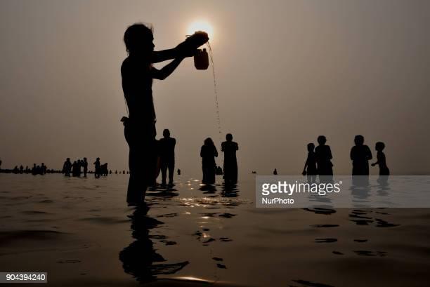 Hindu devotees take a holy bath and perform rituals at the Gangasagar Island around 160 kms south of Kolkata on January 13 2018 More than 900000...