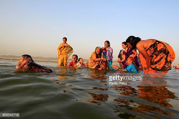 Hindu devotees take a holy dip in the Sangam rivers the Ganga the Yamuna and mythical Saraswati on the occasion of first day of nine day navratri...