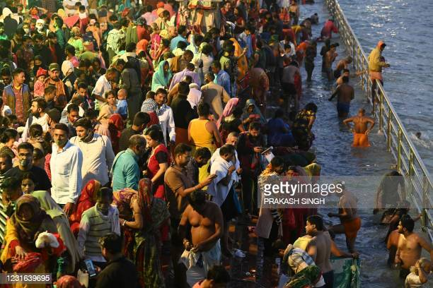 Hindu devotees take a holy dip in the waters of the River Ganges on the Shahi Snan on the occasion of Maha Shivratri festival during the ongoing...