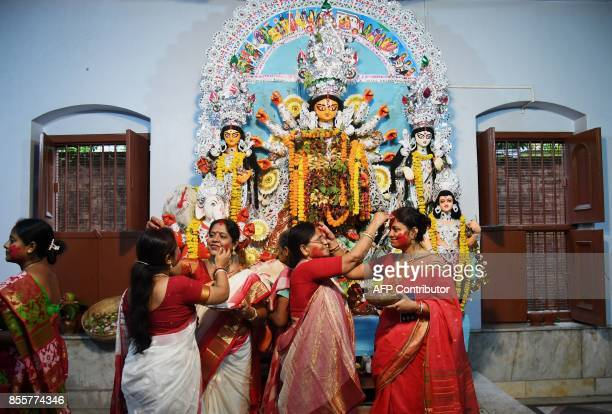 Hindu devotees take part in the Sindoor Khela where married women annoint each other with vermillion powder at a temple during the Durga Puja...