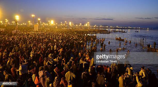 Hindu devotees taking dip in the waters of the holy confluence of Ganga Yamuna and the mythical Saraswati at Sangam on the occasion of Basant...