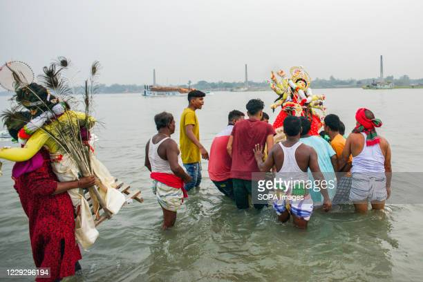 Hindu devotees taking goddess Durga to immersion at Buriganga River after celebrating the final day of the festivity. Durga Puja, also called...