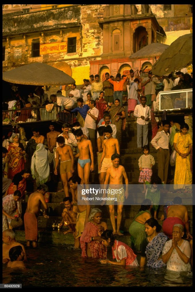 Hindu devotees taking religious bath in : News Photo