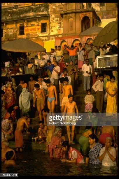 Hindu devotees taking religious bath in River Ganges on Lord Shiva's wedding day, washing away their sins.