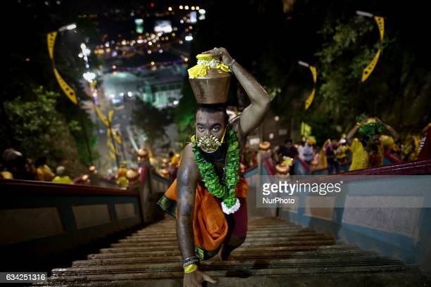 A Hindu devotees tongue is pierced making their way towards the batu cave to perform religious rites for the Thaipusam festival at Batu Caves in...