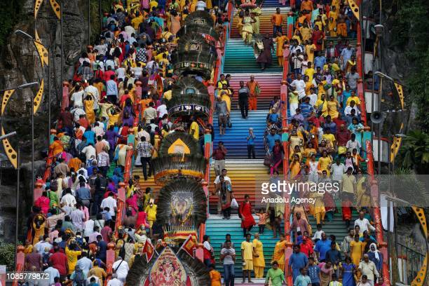 Hindu devotees walk up the 272 steps leading up to the Batu Caves Temple during the festival of Thaipusam in Batu Caves Kuala Lumpur Malaysia on...