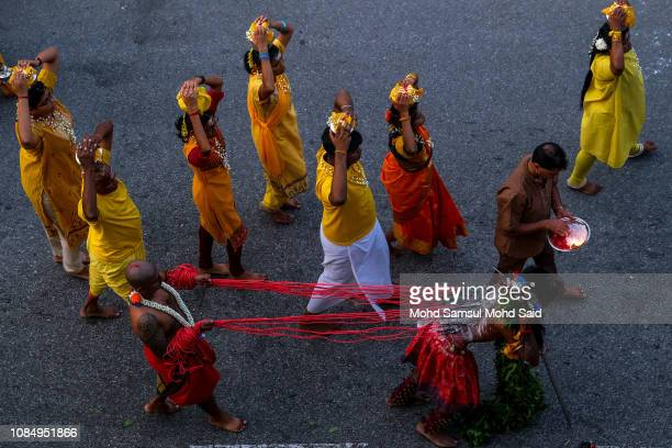 Hindu devotees with hooks pierced into his back spins while making his pilgrimage to the Batu Caves temple during Thaipusam festivals on January 19...