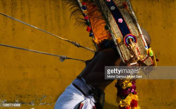 Hindu devotees with hooks pierced into his back spins while making his pilgrimage to the Batu Caves temple during Thaipusam festivals on January 21...