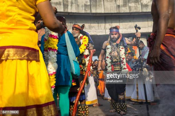 hindu devotees with painful body hooks on thaipusam festival - shaifulzamri stock pictures, royalty-free photos & images