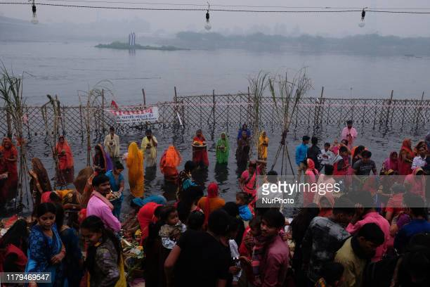 Hindu devotees worship the Sun god along the banks of Yamuna River during the religious Hindu festival of Chhath Puja in New Delhi on November 2,...