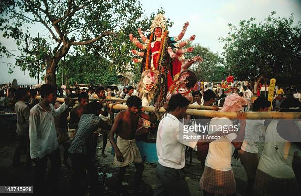 A Hindu diety is paraded on a palenquin during the festival of Dussehra, known as Durga Puja in West Bengal